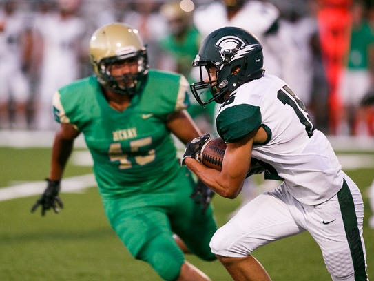 West Salem's Anthony Gould (15) carries the ball as