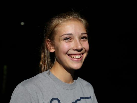 Ellie Schanz, a sophomore volleyball player, stands