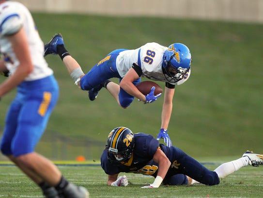 Regina's Ryan Schott tackles Wapello's Bryant Lanz
