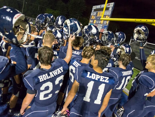 The Marysville Vikings celebrate their win over New