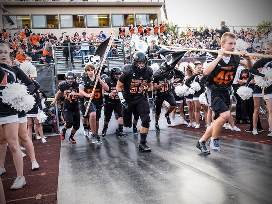 The Marine City Mariners run through the tunnel at