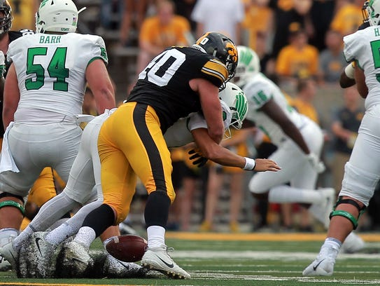 Iowa's Parker Hesse forces a fumble as he sacks North