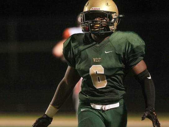 West High's Trumell Roberts celebrates his 68-yard