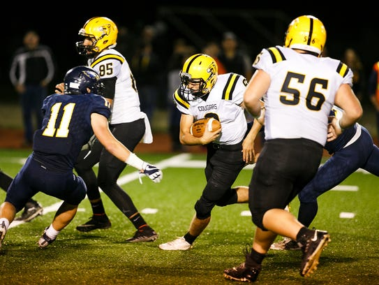 Cascade's Quinn Legner (8) carries the ball in a game