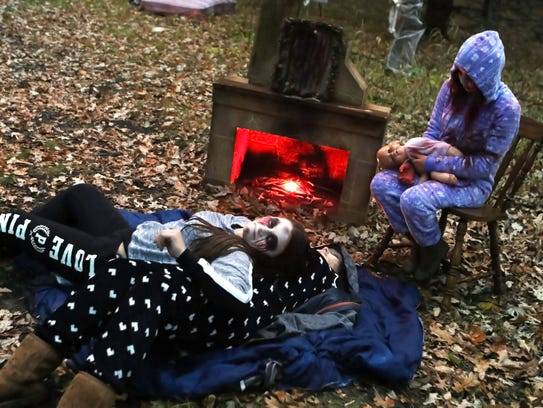 Kettle Moraine Global students wait to scare visitors