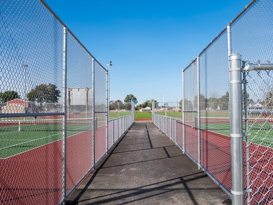 A walkway for spectators was added to the tennis courts