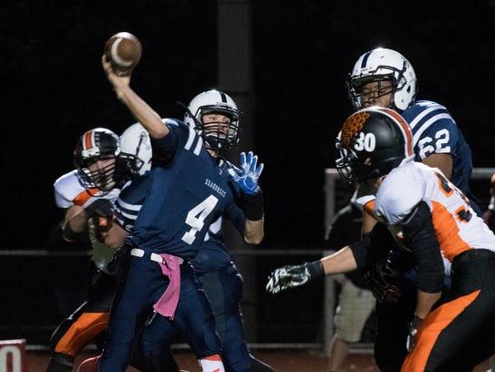 Burlington quarterback Gunnar Bierbaum (4) throws a