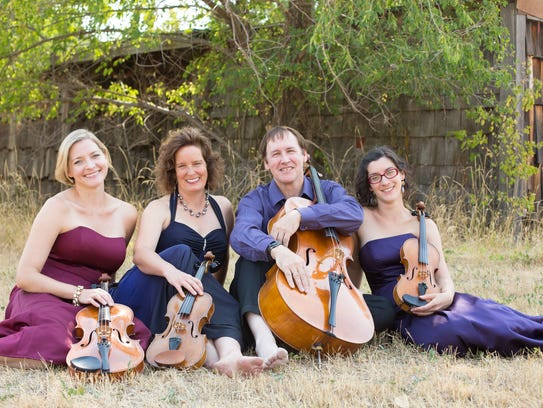 Great Falls Symphony members (from left) Maria Ritzenthaler,