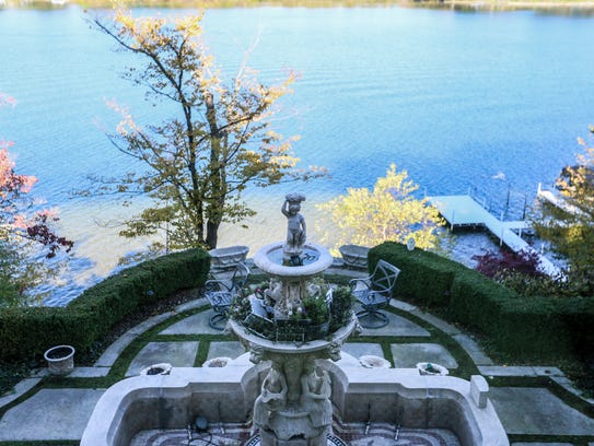 Stone and grass patio looks out to the lake from the