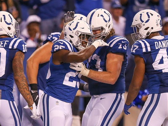The Indianapolis Colts celebrate a third quarter touchdown