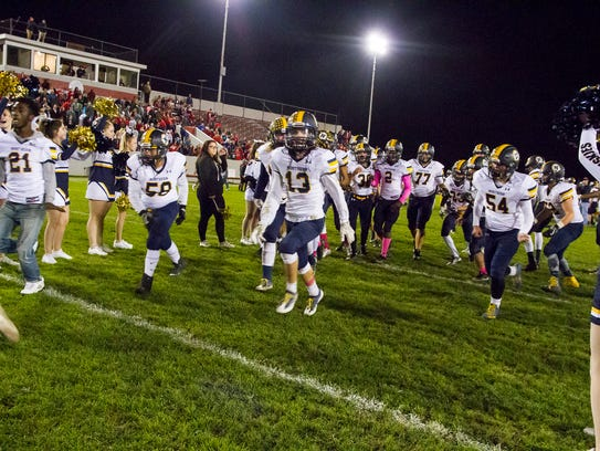 The Port Huron Northern High School Huskies run through