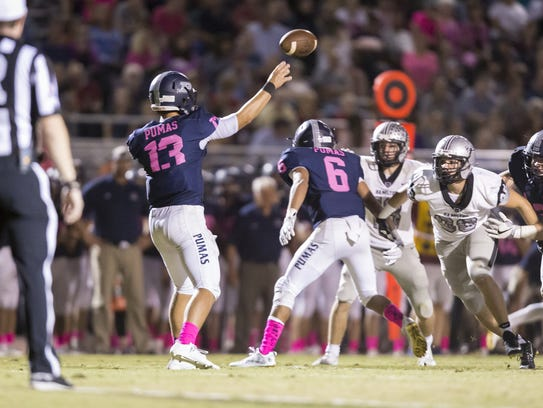 Quarterback Brock Purdy (13) of the Perry Pumas throws