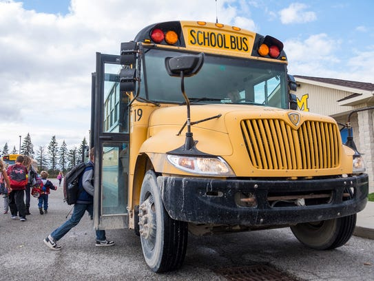 Students board a school bus at Memphis Elementary School