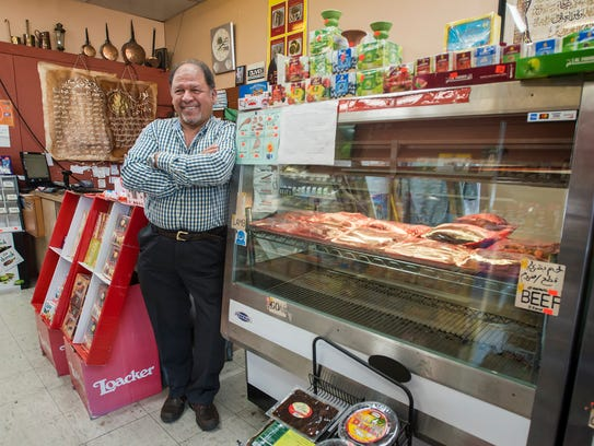 Shop owner Taher Misurati poses in the front entrance