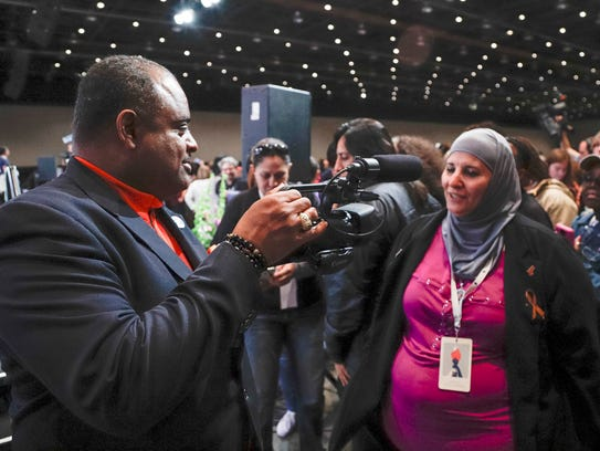Roland Martin, left, interviews Samia Assed of Albuquerque,