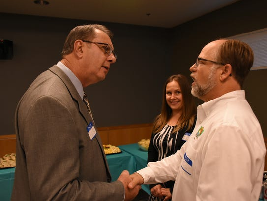 """Lee Niblock, left, speaks with utilities manager Jeff Poteet. The City of Marco Island hosted a """"Meet the City Manager Candidates"""" event Wednesday evening in the City council Chambers."""