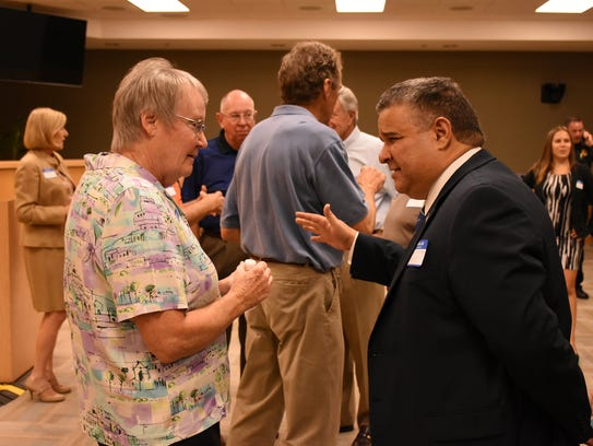 Candidate Daniel Alfonso speaks with Linda Shockley.