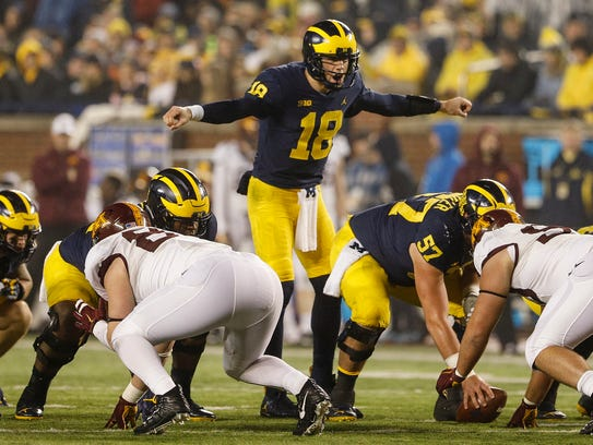 Brandon Peters at the line of scrimmage before a play against Minnesota on Nov. 4.