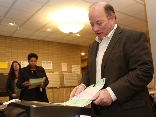 Detroit Mayor Mike Duggan casts his vote in the Detroit