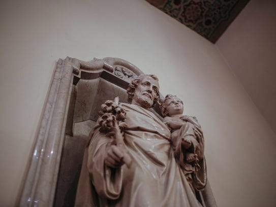 The west side altar features a statue of St. Joseph