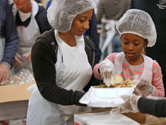 Kim Dunson and her daughter Kayla  volunteered at the