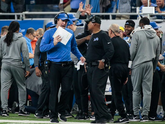 Lions offensive coordinator Jim Bob Cooter, left, talks with head coach Jim Caldwell in the second half on Thanksgiving.