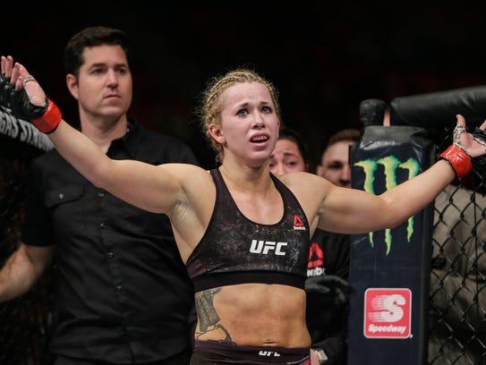 Amanda Cooper, celebrates after defeating Angela Magana