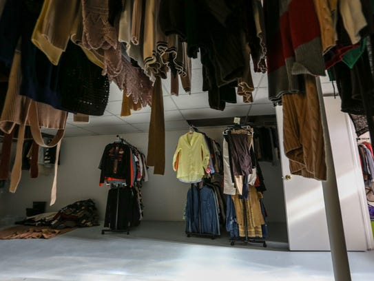 Donations line the walls of the basement clothes closet at Sanctum House.