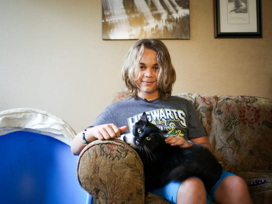 Javon Robbins, 13, holds his cat George on Thursday, Oct. 19, 2017, in Eugene. Javon, who was adopted when he was 21 months old, lives with prenatal alcohol exposure, which can cause him to be extremely anxious, defiant and aggressive.