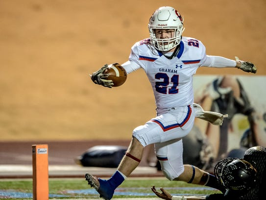Adam Groves strides into the end zone in Graham's Bushland