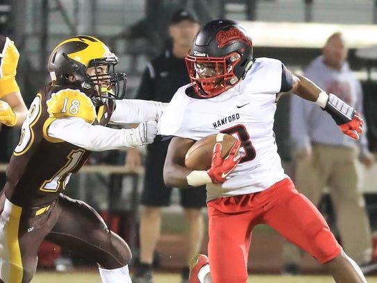 Golden West's William Garza (18) takes down Hanford's
