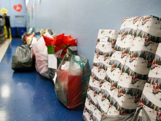 Presents for families at Hoover Elementary are lined