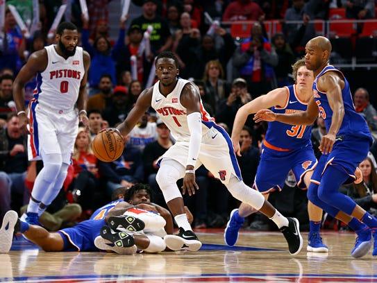 Pistons guard Reggie Jackson (1) recovers the loose