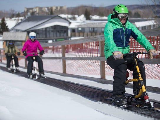 Ski bike riders get a lift up the slope at Killington