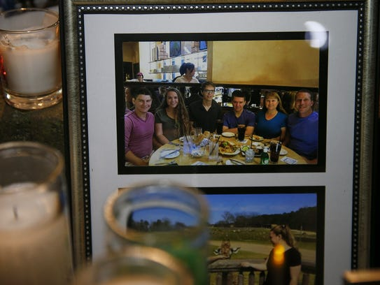 The Kologi family is shown in a photo that was displayed