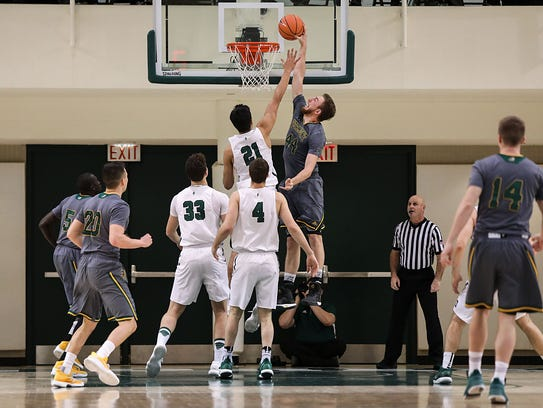The University of Vermont's Nate Rohrer (44) goes in