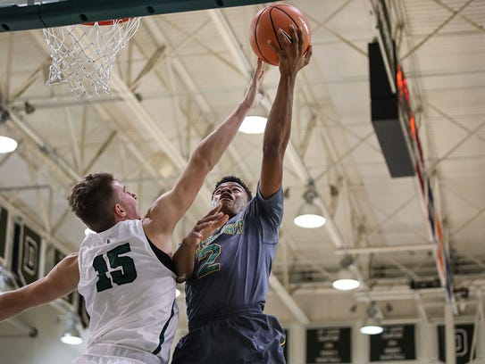 The University of Vermont's Trae Bell-Haynes (2) makes