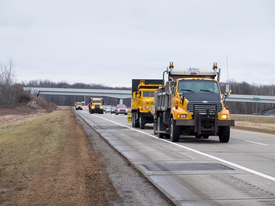 St. Clair County Road Commission trucks work on patching
