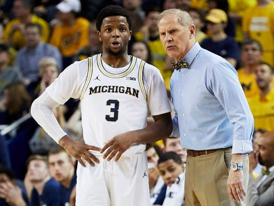 Zavier Simpson and John Beilein during a game against Rutgers.