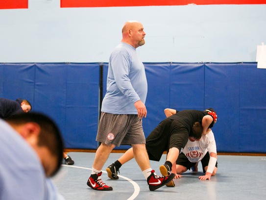 South Salem wrestling Scott DuFault works with athletes