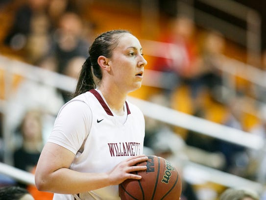 Willamette University's Kylie Towry (20) is on the