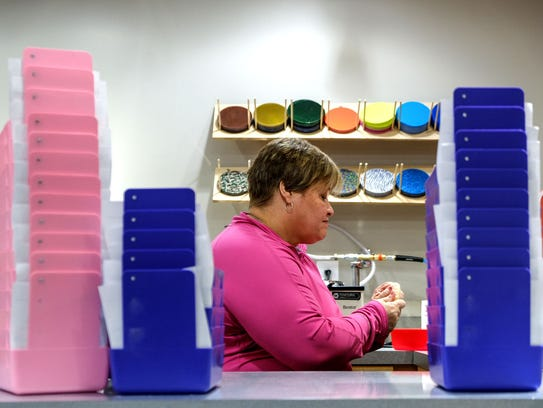 Trays stacked with orders as Motor City Lab Works lab