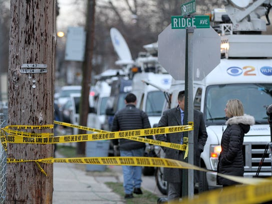 Media trucks line up near the scene of the fatal shooting