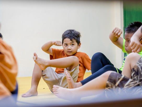 Students practice defensive martial arts techniques