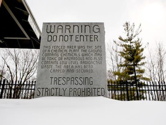 A granite gravestone that once warned people of hazardous