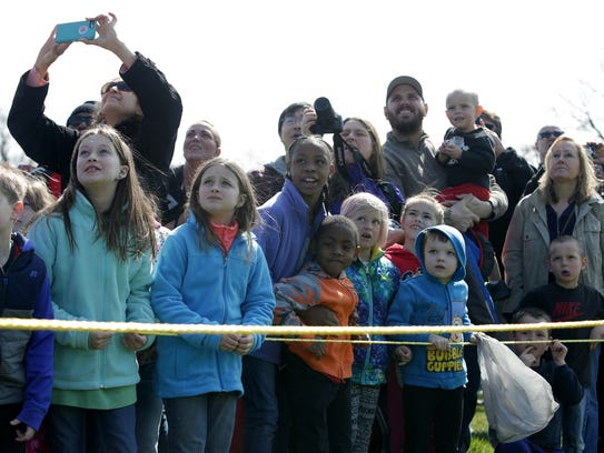Kids and parents waited behind a yellow rope for the marshmallows to fall last year at Nankin Mills Park in Westland.