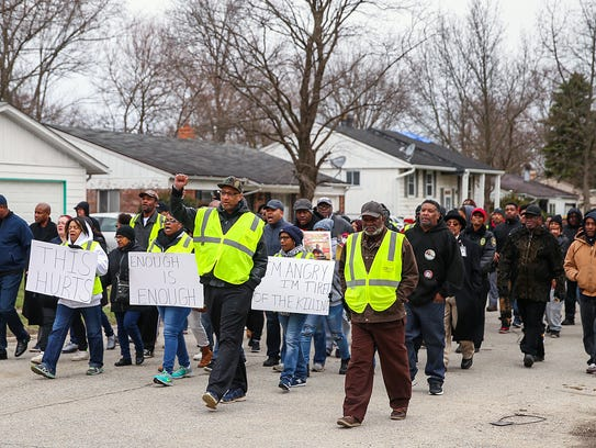 "More than 100 people walk through the neighborhood where 1-year-old Malaysia Robson was killed. The ""Let's March for Malaysia"" march was led by the Ten Point Coalition on the east side of Indianapolis on March 31, 2018."