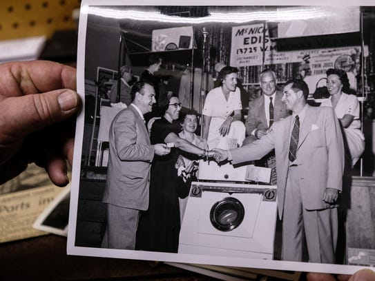 McNichols Electric co-owner Pat Kehoe shows a photo