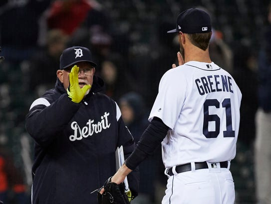 Tigers manager Ron Gardenhire and closer Shane Greene celebrate the win Tuesday.