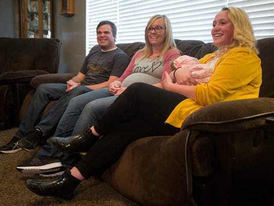 From left, Wendell Creager, Laura Creager, Morlie Hayes, 16, and Creager's daughter, Kayla Faith Creager talk at the Hayes' home in Eden, Utah. Hayes unexpectedly delivered her aunt's newborn in the bathroom of her home on April 28.